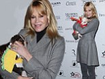 Happy Howl-oween! Melanie Griffith cuddles dogs dressed in tiny taco and crab costumes
