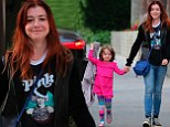 Pretty in P!nk! Alyson Hannigan rocks a concert t-shirt of the songstress while her lookalike daughter Satyana stands out in a fuchsia dress
