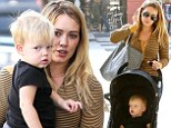 In good hands: Hilary Duff carried son Luca on Sunday as she went shopping with a gal pal in Beverly Hills, California