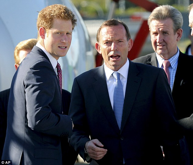 Talks: Prince Harry (left) speaks with Australia's Prime Minister Tony Abbott (right) at Sydney Airport today