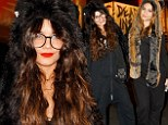Joining the pack! Vanessa Hudgens has a howling good time with sister Stella in wolf ears and paws at Halloween party