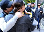 Class act: Orlando Bloom and Miranda Kerr ensure son Flynn sees affectionate moment between them despite separation