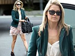 Dressed to frill! Heroes star Ali Larter shows off her toned legs in floral pink micro-mini skirt during shopping trip