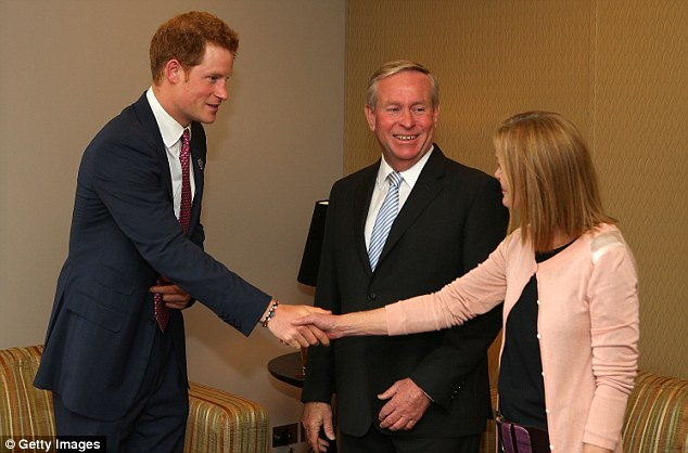 Greetings: Prince Harry meets with West Australian Premier Colin Barnett and his wife Lyn after arriving in Perth