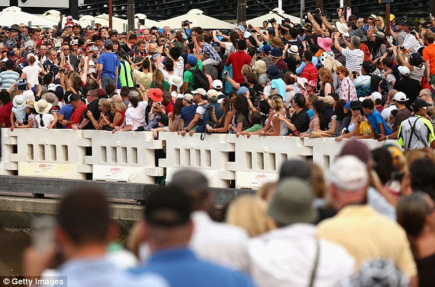 Adulation: Tens of thousands of screaming fans turned out to catch a glimpse of Prince Harry