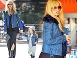 Eating for two! Pregnant Rachel Zoe shows off blooming baby bump as she and son Skyler treat themselves to frozen yoghurt