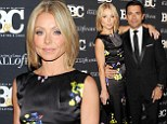 'Big night out!' Kelly Ripa is radiant in a black floral gown as she attends awards bash with husband Mark Consuelos