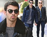 United front: Joe Jonas and girlfriend Blanda Eggenschwiler held hands on Monday as they walked in New York City and looked content despite drama with the Jonas Brothers