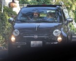 Naughty: Noah Cyrus, 13, illegally gets behind the wheel of a Fiat as dad Billy Ray rides shotgun in the passenger seat