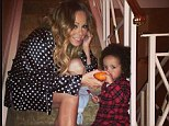 Her little pumpkin: Mariah Carey shared a special moment on Sunday by posting this cute picture of Roc with a miniature pumpkin