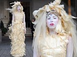 Lady Gaga braves the storm in a bizarre dress made out of crepe paper in London on Monday