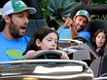 Driving Miss Sadie! Adam Sandler lets his seven-year-old daughter take the wheel (but don't worry, it's only on a Disneyland ride)