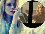 Lindsay Lohan enjoys lazy Sunday posting selfies 'in bed' following wine bottle scandal and latest legal troubles