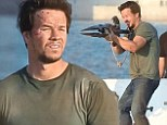 It's not all fun and games! Filming for Transformers: Age of Extinction continues as Mark Wahlberg shows his playful side during shoot