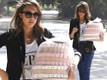 Many nappy returns! Jessica Alba heads to party armed with gift-wrapped diaper cake