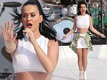 It really works! Katy Perry jumps rope on stage while flashing toned midriff in a crop top as she performs Down Under
