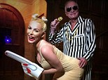 Scary stuff: Hugh Hefner shared this picture of him with wife Crystal in their Miley and Robin Halloween costumes