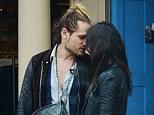 Kiss: Actress Zoe Saldana and her new husband get close while shopping along Abbott Kinney Boulevard in Venice Beach, LA
