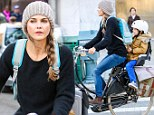 Pedal power! Keri Russell stays active as she picks up her adorable son River from school on a vintage bicycle