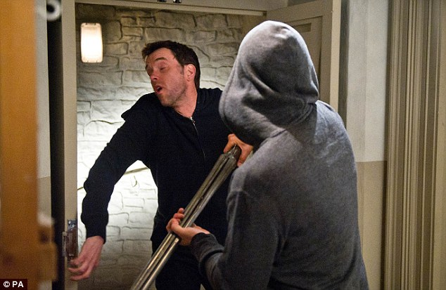 Murderous intentions: Bartender and chef Marlon (Mark Charnock) is knocked out by Cameron before he takes the pub hostage