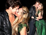 Step away from the 24-year-old! Cougar Adrienne Maloof, 52, goes in for the kill as she plants a very passionate kiss on toyboy lover Jacob Busch