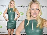 Melissa Joan Hart sheds squeaky clean image in skintight leather frock at launch of controversial memoir