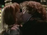 History making: Paul McGann as the eighth Doctor kisses his companion Grace Holloway (Daphne Ashbrook), the first time a snog has ever been shared between the Time Lord and his companion