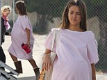 Oh baby! Jessica Alba shows off huge prosthetic bump while dressed in a hospital gown on set of new movie