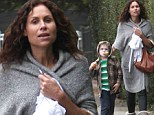 Bare-faced Minnie Driver bundles up in cosy sweater during afternoon stroll with son Henry