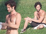 Now that's something to gossip about! Penn Badgley shows off his physique by stripping down in a public park