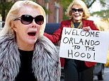 Are we desperate? Joan Rivers goes from drab to dazzling as she welcomes Orlando Bloom 'to the hood' with a sign and sweets
