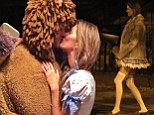 'Having fun with my lion!' Gisele Bundchen shows off her endless legs in Dorothy costume as she shares a kiss with mane man Tom Brady