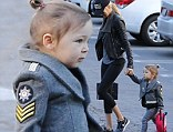 Mommy duty: Kimberly Stewart held the hand of her daughter Delilah on Monday as she dropped her off at pre-school