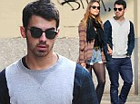 And then there were two! Joe seeks solace on the streets of New York with his girlfriend Blanda Eggenschwiler as he makes his first appearance since Jonas Brothers split
