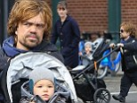 It's the match Game...of Thrones: Peter Dinklage and wife Erica Schmidt take their daughter out for a stroll in New York in coordinated outfits