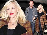 'Pregnant' Gwen Stefani can't hide her smile as she steps out arm-in-arm with husband Gavin Rossdale
