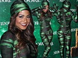 She's no wallflower but Christina Milian blends in to the background at Midori Green Halloween Party in skintight camouflage bodysuit