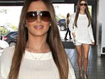 Cheryl Cole flashes barbed wire thigh tattoo as she displays her toned legs in tiny shorts and gold boots at LAX