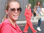 Great escape! 'Pregnant' Kendra Wilkinson breaks away in bright orange tracksuit for a girls' day out ahead of show's season finale