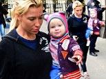 My little cuddly bear! Tracy Anderson shows off her baby girl Penelope during New York stroll