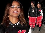 We're a perfect match! Christina Milian and boyfriend wear SAME red bandana trousers on night out