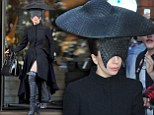 Lady Gaga hides her face in bizarre hat as she wears all black mourning the death of her dog Alice