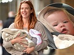 Beaming Poppy Montgomery shows off gorgeous lookalike daughter Violet during first public outing since her April birth