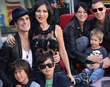 Family photo: Perry posed with his wife Etty and their two sons on the band's new star