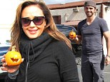 Carving a reputation for themselves! Leah Remini and Dancing With The Stars partner Tony Dovolani pose with pumpkin