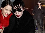 Who needs a costume: Marilyn Manson fits right in despite his lack of fancy dress as he hosts Halloween bash in Vegas