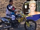Pink defends husband Carey Hart after he takes two-year-old daughter Willow for motorcycle ride... without a helmet