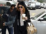 Lindsay Lohan attempts to go incognito as she dashes into a building following MORE claims she has fallen off the wagon