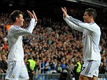 Duo: Gareth Bale and Cristiano Ronaldo high five during Real Madrid's 7-3 win over Sevilla