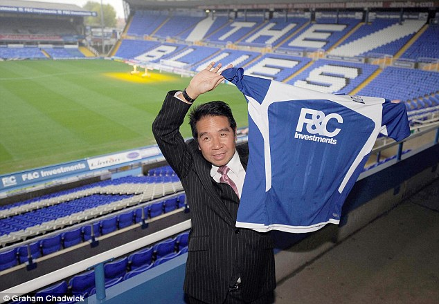 Where it all began: Yeung holds a Birmingham shirt after buying the club